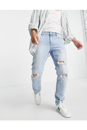 ASOS Slim jeans with knee rips in vintage light wash blue