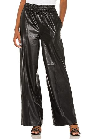 BLANK NYC Faux Leather Wide Leg in - Black. Size L (also in M, S, XS).