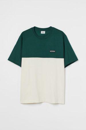 H&M T-shirt com blocos de cor