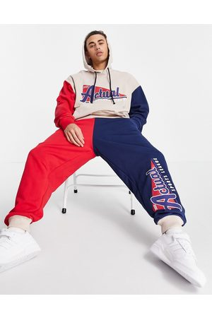 ASOS Homem Joggers - Relaxed joggers with colourblock detail and vintage sports print in burgundy and navy-Red