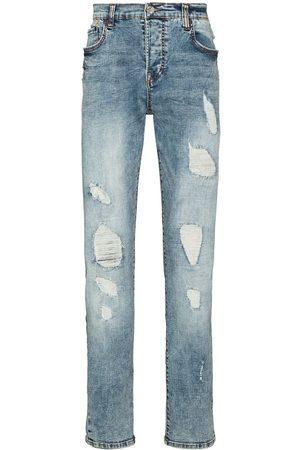 True Religion Homem Slim - Distressed ripped slim-fit jeans