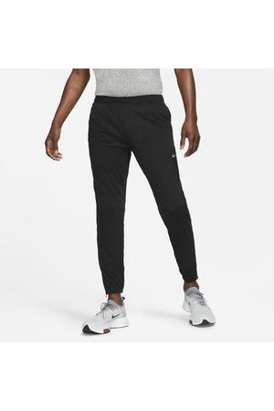Nike Homem Calças Desportivas - Calças de running em malha Dri-FIT Challenger para homem