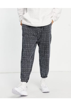 ASOS DESIGN Homem Joggers - Oversized joggers in black with all over Chicago city print