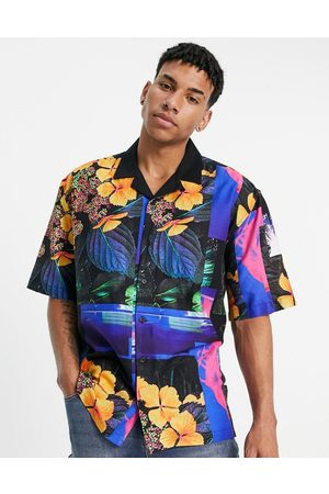 Topman Homem Casual - Oversized short sleeve shirt with floral print in black with contrast collar