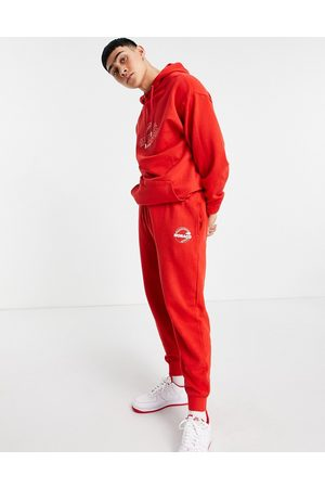 ASOS Homem Joggers - Co-ord oversized joggers in red marl with Monaco city print