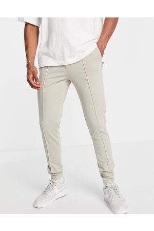 ASOS Homem Joggers - Skinny smart trouser in stone jersey with jogger cuff-Neutral