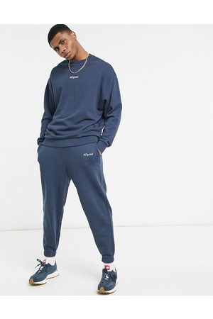 ASOS DESIGN Homem Joggers - Co-ord oversized joggers in washed navy with text print