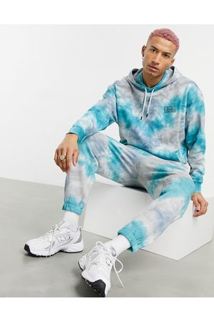 ASOS Homem Joggers - Co-ord oversized joggers in blue and grey tie dye with San Francisco embroidery-Multi