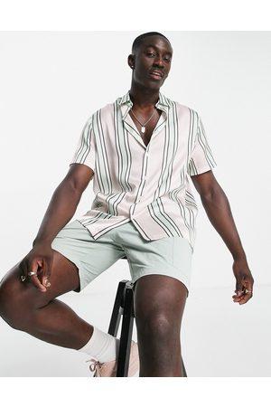 ASOS Homem Casual - Relaxed stripe shirt in pink satin