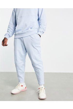 ASOS Homem Joggers - Co-ord high waisted oversized joggers with seam details in blue