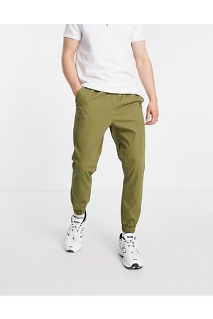 ASOS DESIGN Tapered chino joggers with elasticated waist in khaki-Green