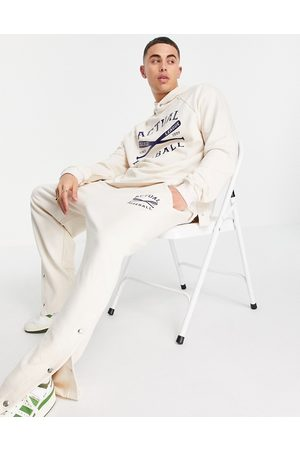 ASOS Homem Joggers - Co-ord relaxed straight leg joggers with vintage sports print and side popper detail in ecru-White