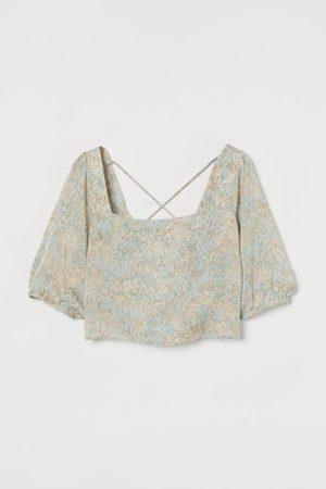 H&M Blusa com costas abertas