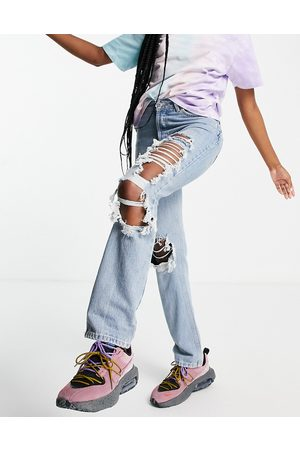 ASOS Mid rise '90's' straight leg jeans in lightwash with rips-Blue