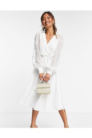 ASOS Embroidered wrap midi dress with satin and lace trim detail-White