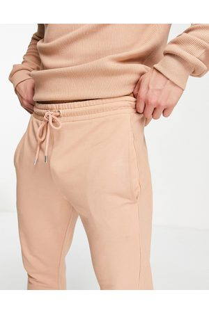 ASOS Co-ord skinny joggers with rib side panel in orange-Brown