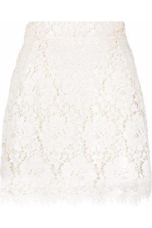 Dolce & Gabbana Mulher Mini-saias - Laminated lace mini skirt