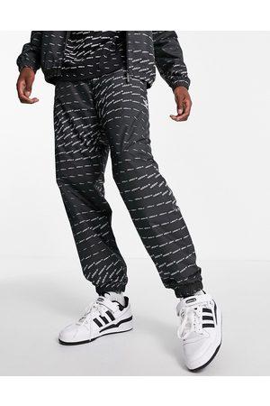 adidas Originals Repeat logo joggers in black