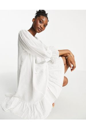 In The Style X Lorna Luxe tiered smock mini dress with tie neck in white