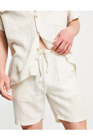 ASOS DESIGN Co-ord skater shorts in natural look textured fabrics-Neutral