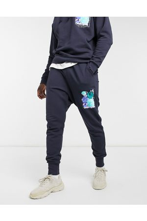 ASOS DESIGN Co-ord tapered joggers in navy with flower print