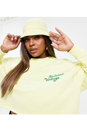 Reclaimed Vintage Inspired plus cropped sweat in yellow with embroidery