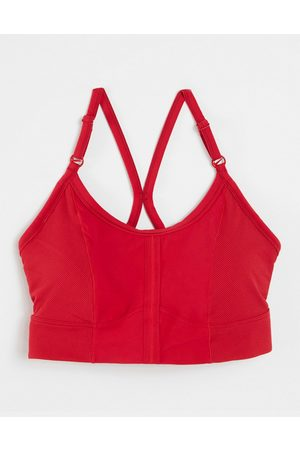 Nike Training Nike Yoga Indy light support strappy sports bra in red