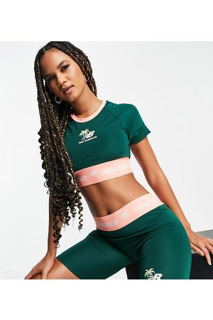 New Balance Legging shorts with logo banding in green and coral - exclusive to ASOS