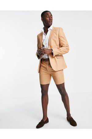 ASOS DESIGN Super skinny suit shorts in tan cotton linen-Brown