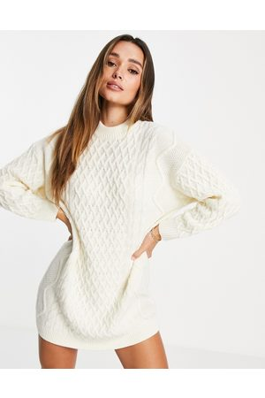 ASOS DESIGN Knitted mini dress in cable knit in cream-White