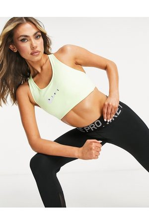 Nike Training Swoosh mid support sports bra in lime-Green
