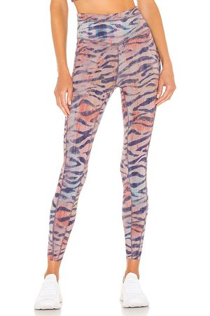 Free People X FP Movement Beat The Heat Reversible Legging in - Lavender. Size L (also in M, S, XS).