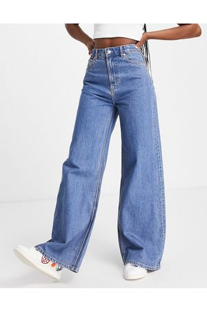 Weekday Ace organic cotton high waist wide leg jeans in mid wash 90's blue