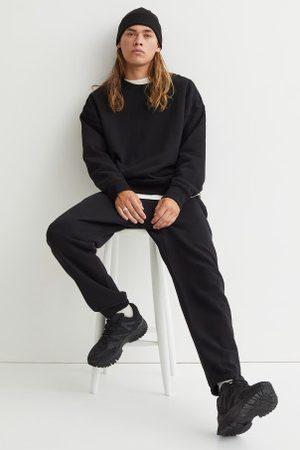 H&M Joggers em algodão