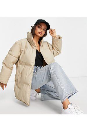 ASOS Petite ASOS DESIGN Petite rubberised oversized puffer jacket in camel-Neutral