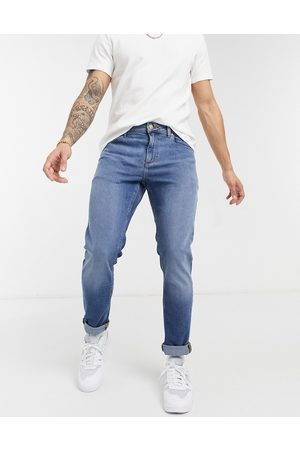 ASOS DESIGN Stretch slim jeans in 'less thirsty' mid blue wash