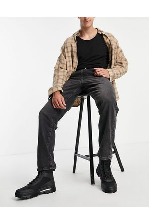 ASOS DESIGN Homem Retos - Straight leg jeans with double pleat in washed black