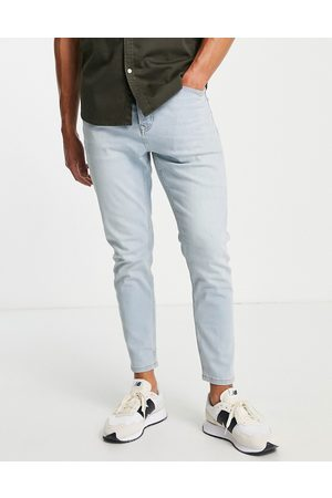 Topman Homem Tapered - Stretch tapered jeans in light wash tint-Blue