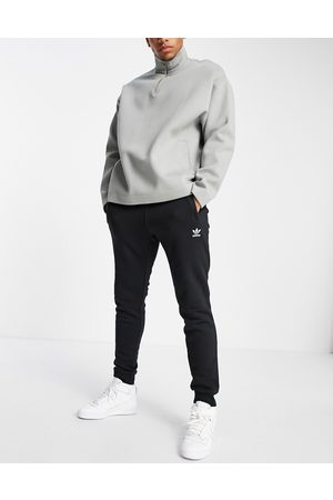 adidas Essentials slim fit joggers with small logo in black
