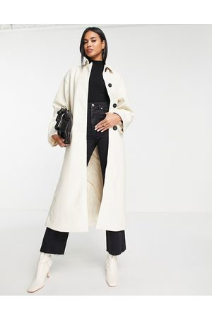ASOS DESIGN 90s faux leather trench coat in cream-White