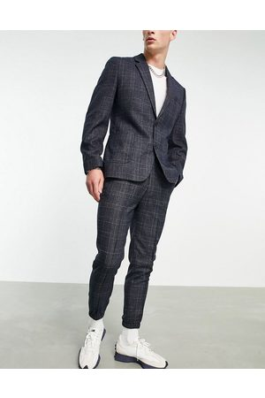 ASOS DESIGN Tapered suit trouser with cuff in navy check