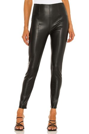 Free People Spitfire Stacked Skinny Legging in - Black. Size 24 (also in 26, 28, 29, 30, 31, 25, 27).