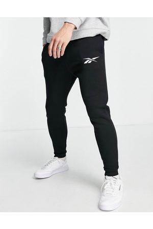 Reebok Core logo joggers in black
