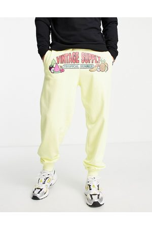 Vintage Supply Tropical summer print joggers in yellow
