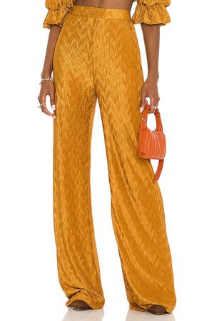 House of Harlow X REVOLVE Sevigny Pant in - Mustard. Size L (also in S, M, XS, XXS, XL).