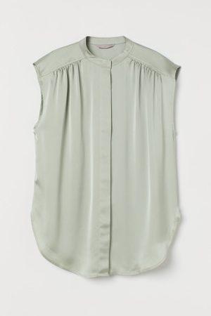 H&M Blusa com brilho