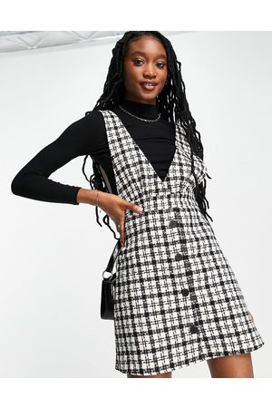 New Look Boucle check v neck pinny dress in black