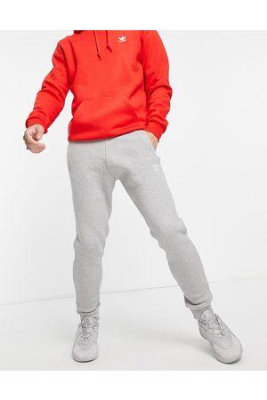 adidas Originals Homem Joggers - Essentials slim fit joggers with small logo in grey