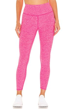 alo 7/8 soft Highlight Legging in - Pink. Size L (also in M, S, XS).
