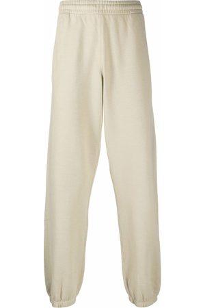 OFF-WHITE Arrow print slim track trousers